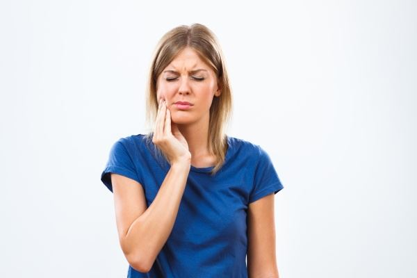 woman with mouth pain